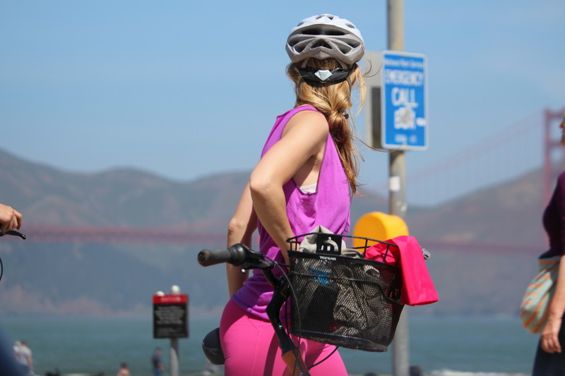 hansome cyclist babe in pink leggings