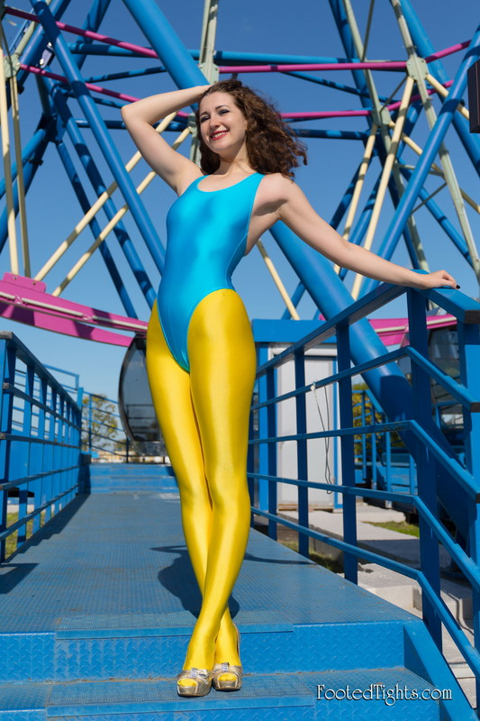 horny woman Margo in yellow leggings & blue swimsuit