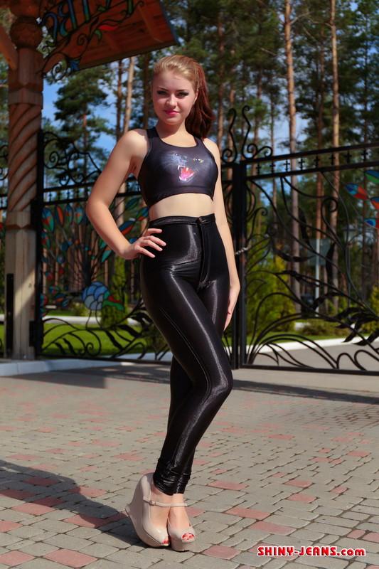 slavic model Nadya K in shiny jeans & high heels