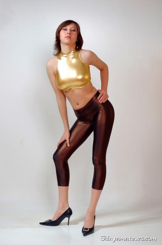 gorgeous woman Dasha G in wetlook pants