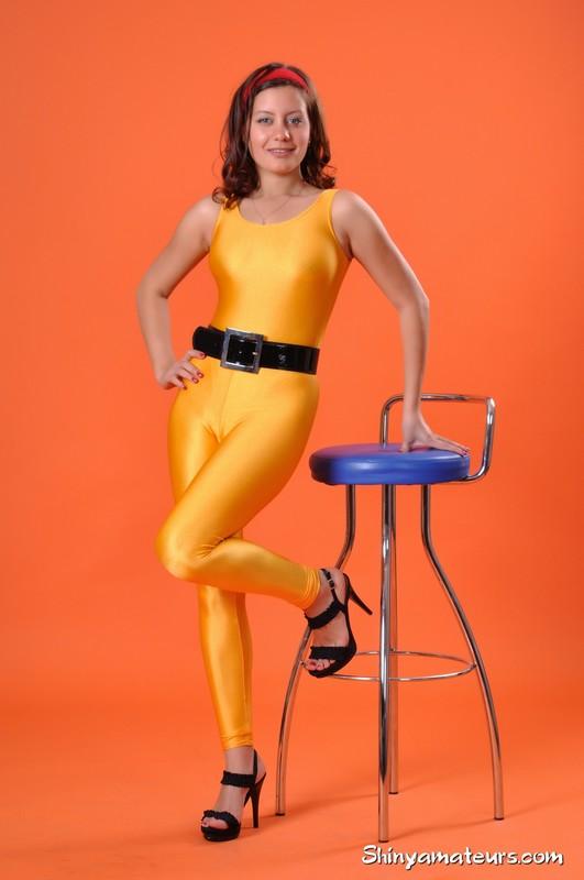 beautiful female Vera G in naughty orange unitards