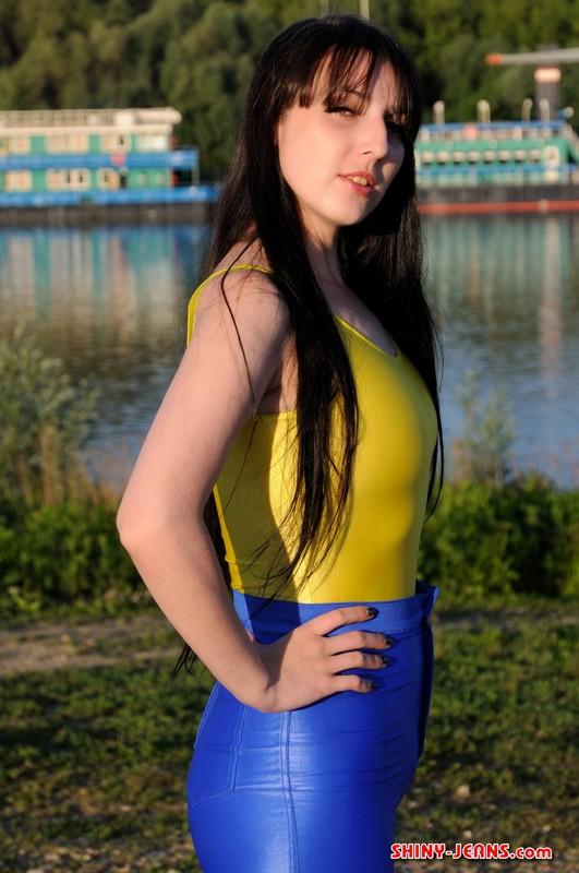 brunette lady Irina D in tight blue jeans