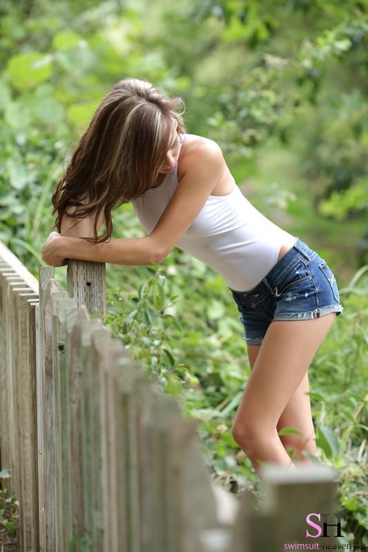 beautiful girl Kelly M in white asics & jean shorts