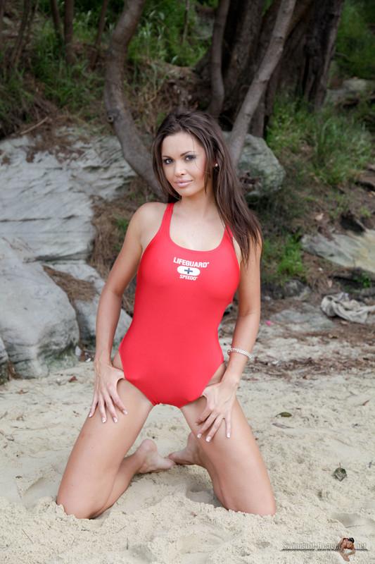 beach lifeguard Marissa in red speedo swimwear
