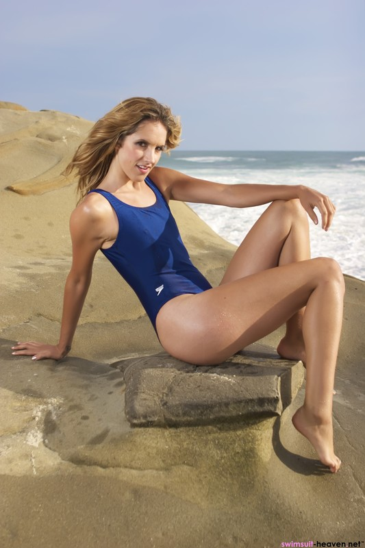 beach lifeguard Franny in blue speedo swimsuit