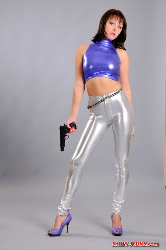 detective lady Christina with pistol & silver tight disco pants