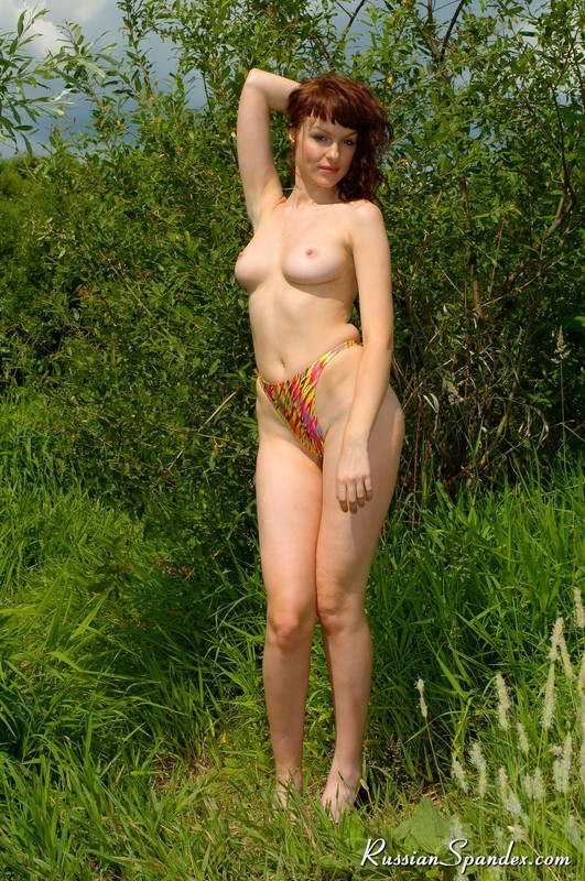topless bikini lady hikinig in the siberian forest