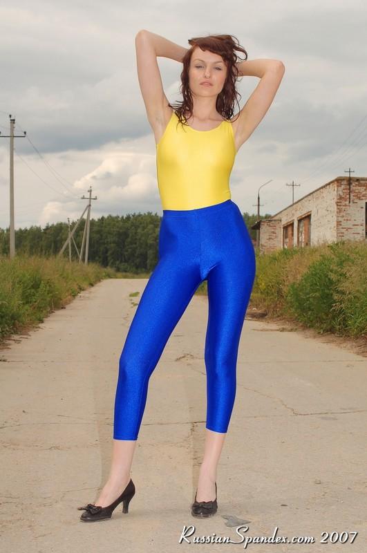 petite female in blue leggings & high heels
