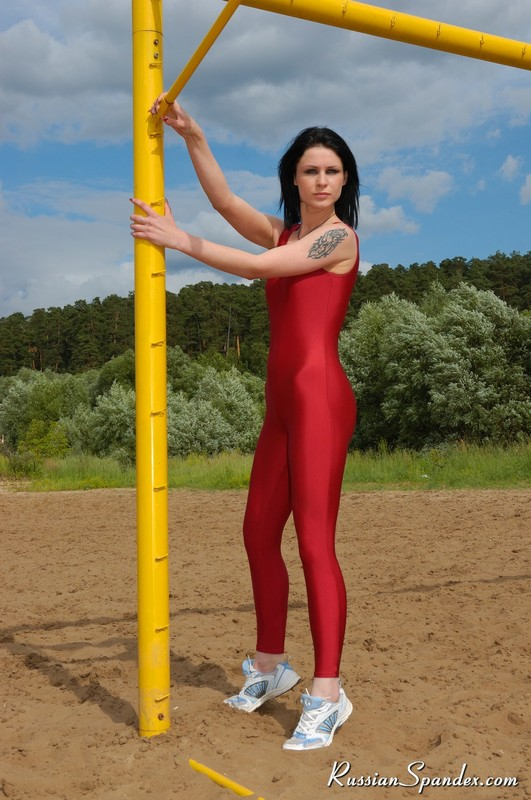 brunette jogger lady in sexy red unitards