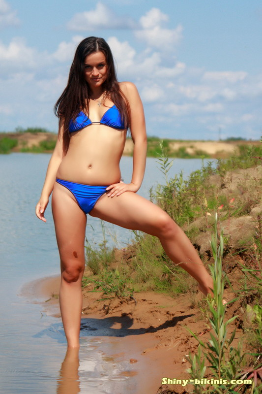 charming beach girl Yana in blue bikini