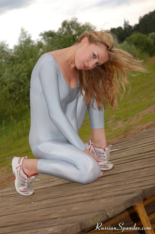 sporty lady in grey catsuit