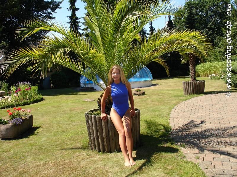 beautiful model in blue speedo swimsuit