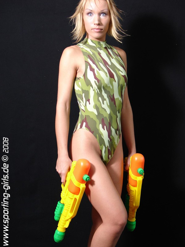 pretty blonde Diana with camouflage swimsuit & water guns