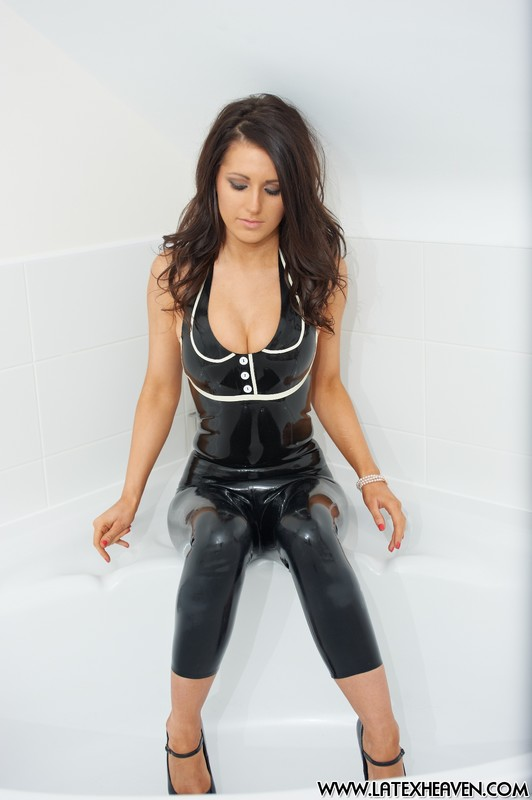 bathroom girl Lana in black latex unitards