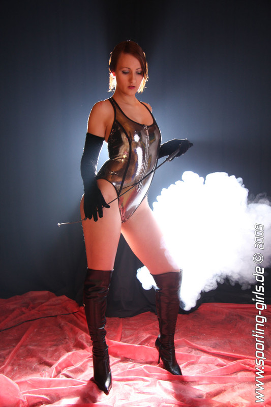 horny babe Kathy in silver wetlook swimsuit & leather boots
