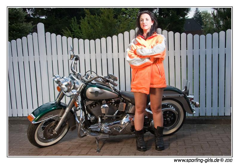 biker girl Angelina in camouflage bikini