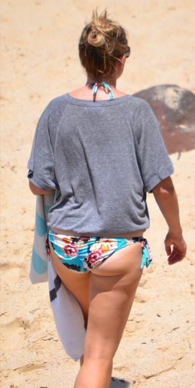 curvy beach milf in T-shirt and bikini