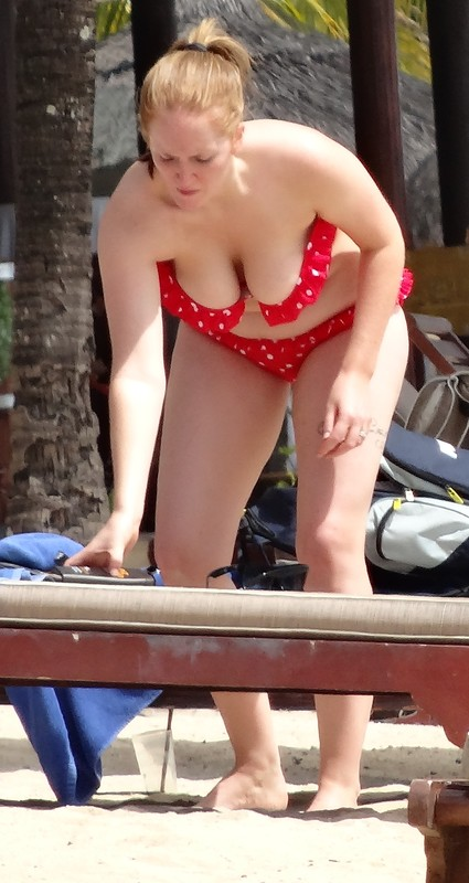 busty woman in red polka dot bikini