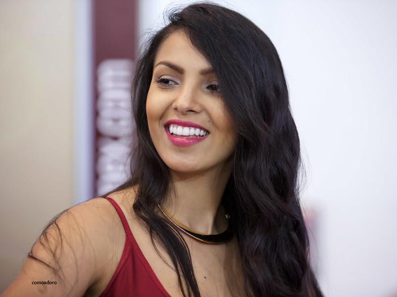 latina promo girl in burgundy spandex clothes
