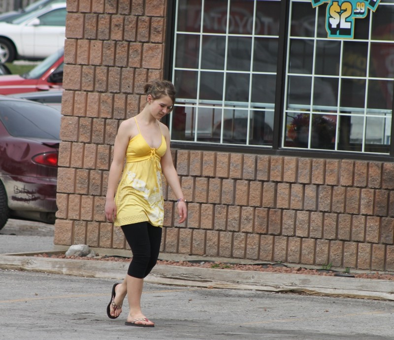 lovely chick in low cut dress & leggings