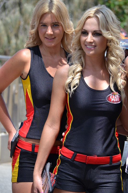 lovely promo girls in shiny outfit