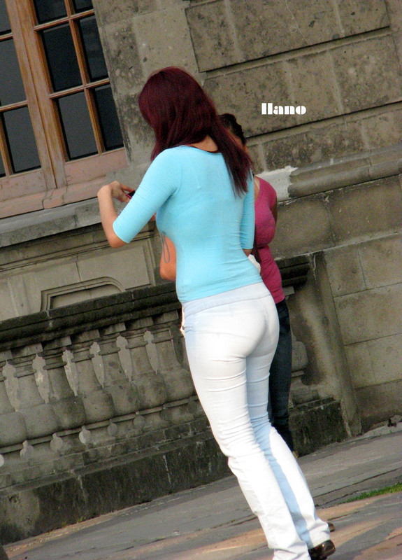 cheerful woman in tight denim pants
