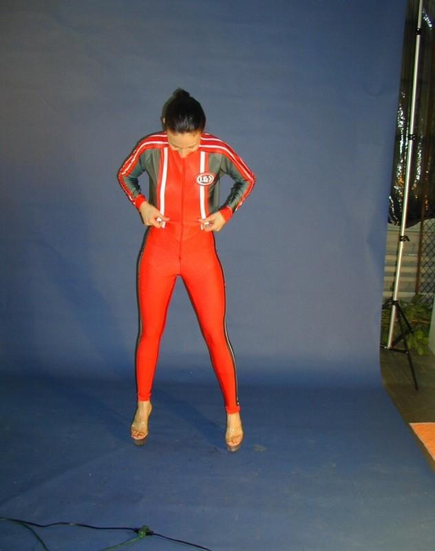 pretty woman in shiny tight bodysuit