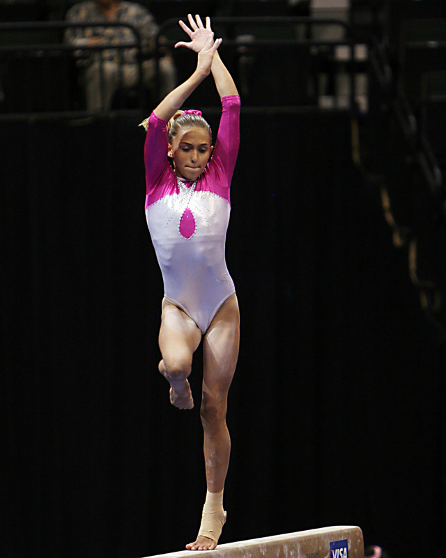 gymnastic competition teens in shiny leotards
