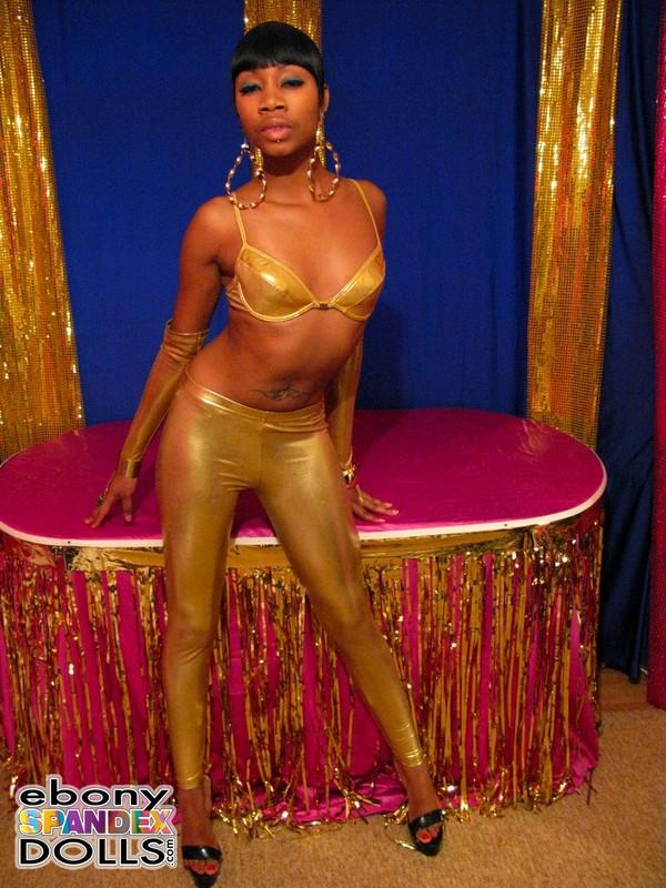 african lady Nyhoka in sexy golden metallic leggings