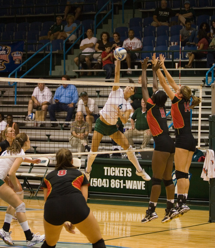 college volleyball girls in green spandex shorts
