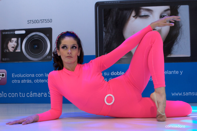 flexy promo girl in pink catsuit