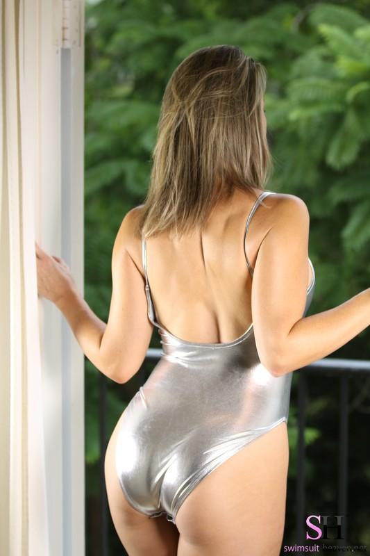 curvy model Alexis in silver swimsuit