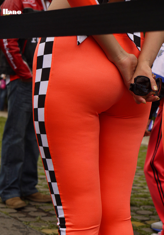 car show girls in orange lycra