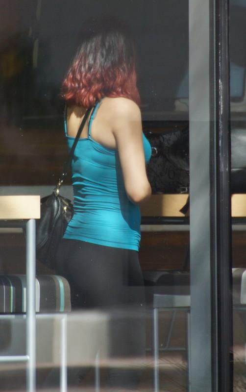 charming woman in black lycra pants