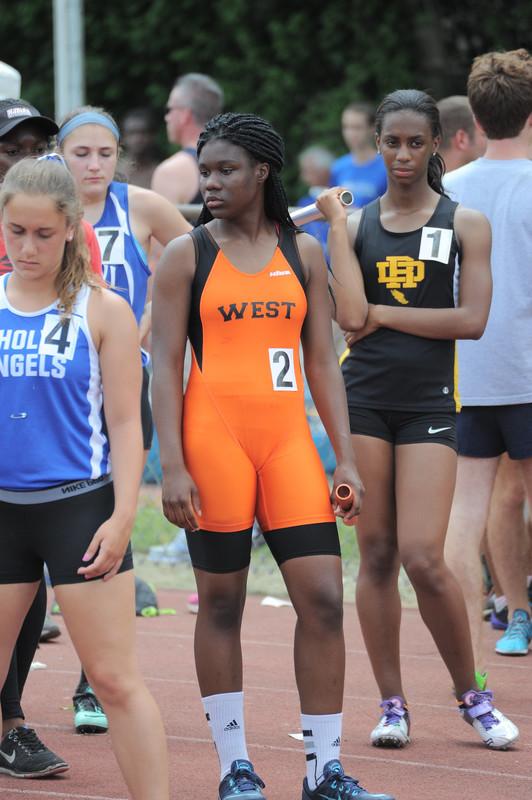 ebony college teen in tight orange sportswear