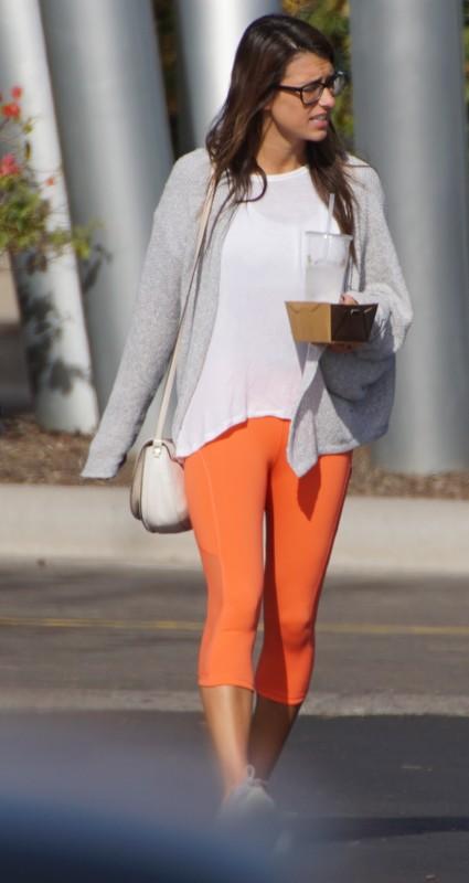 handsome woman in orange leggings