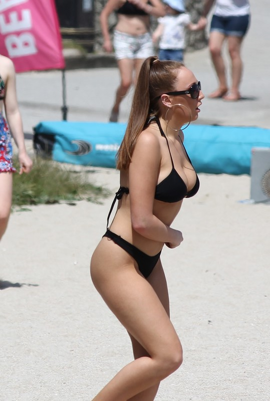 pretty female in black bikini