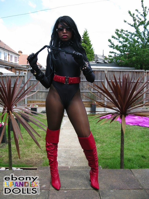 ebony dominatrix Peaches in black leotards & red boots