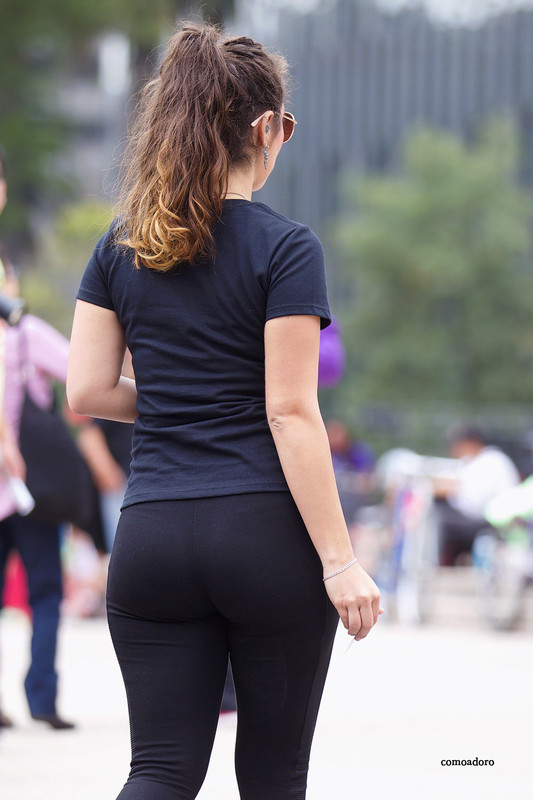 gorgeous hispanic lady in tight black lycra pants