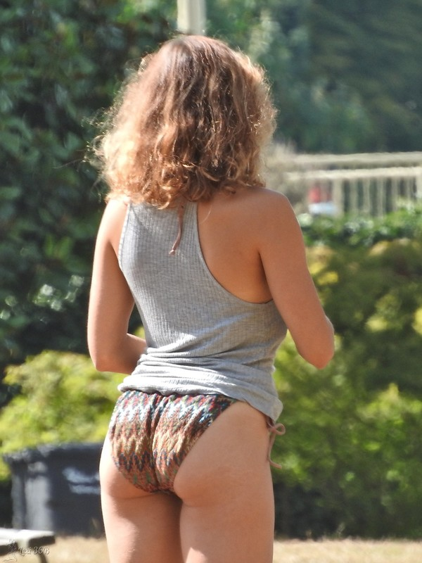 handsome studen lady in jean shorts & bikini