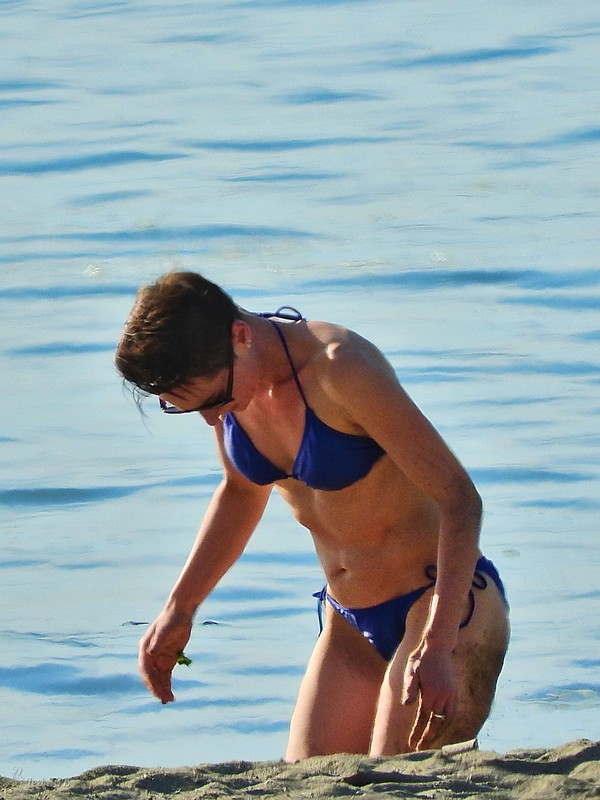 sporty milf at the beach in a blue bikini